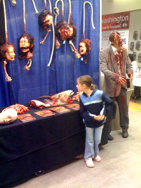 A little girl checks out the severed heads.